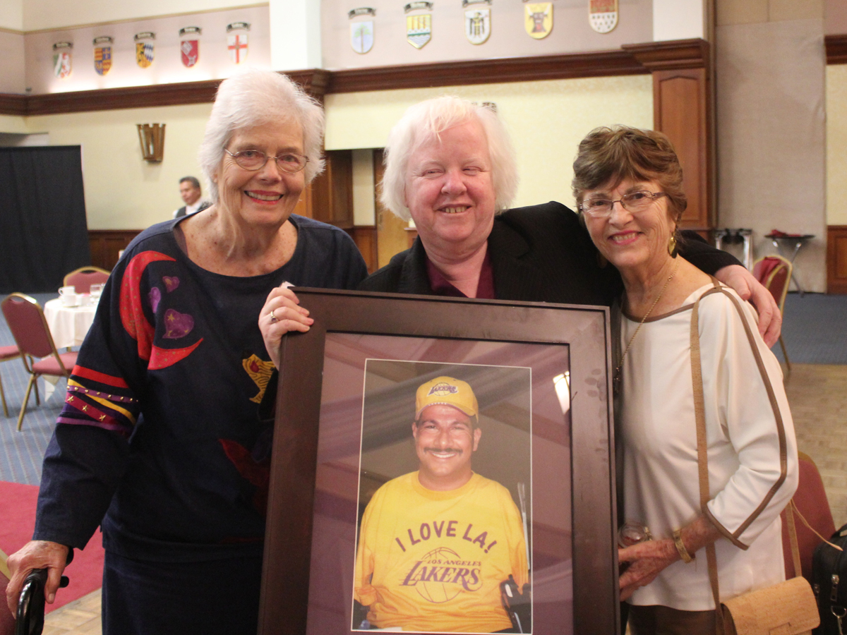 Apple2015 Board Members, Norma and Kay with Brenda Premo holding picture of Richard Devylder
