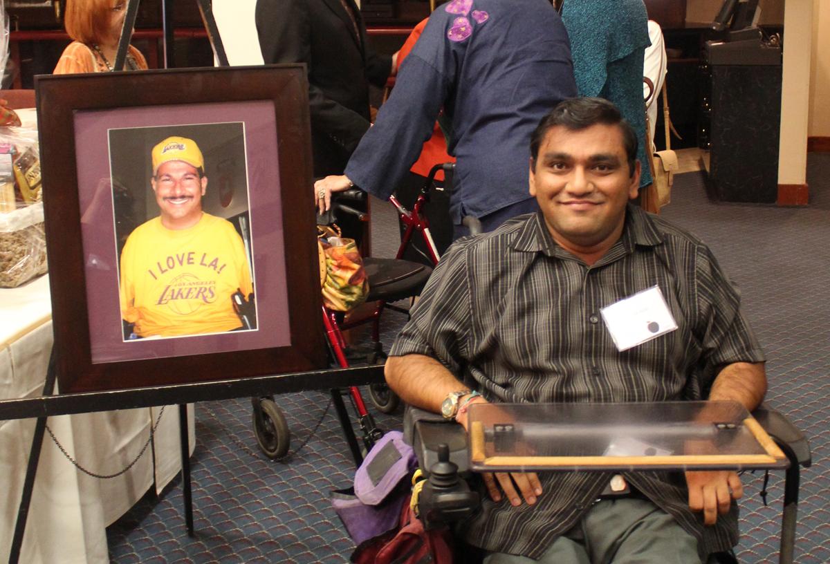 Apple2015 Ed Roberts Awardee, Bhumit holding picture of Richard D
