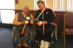 Apple2015 DMC Staff Mir with Speaker Angela M. holding her medals