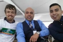 3 men posing at NCIL event