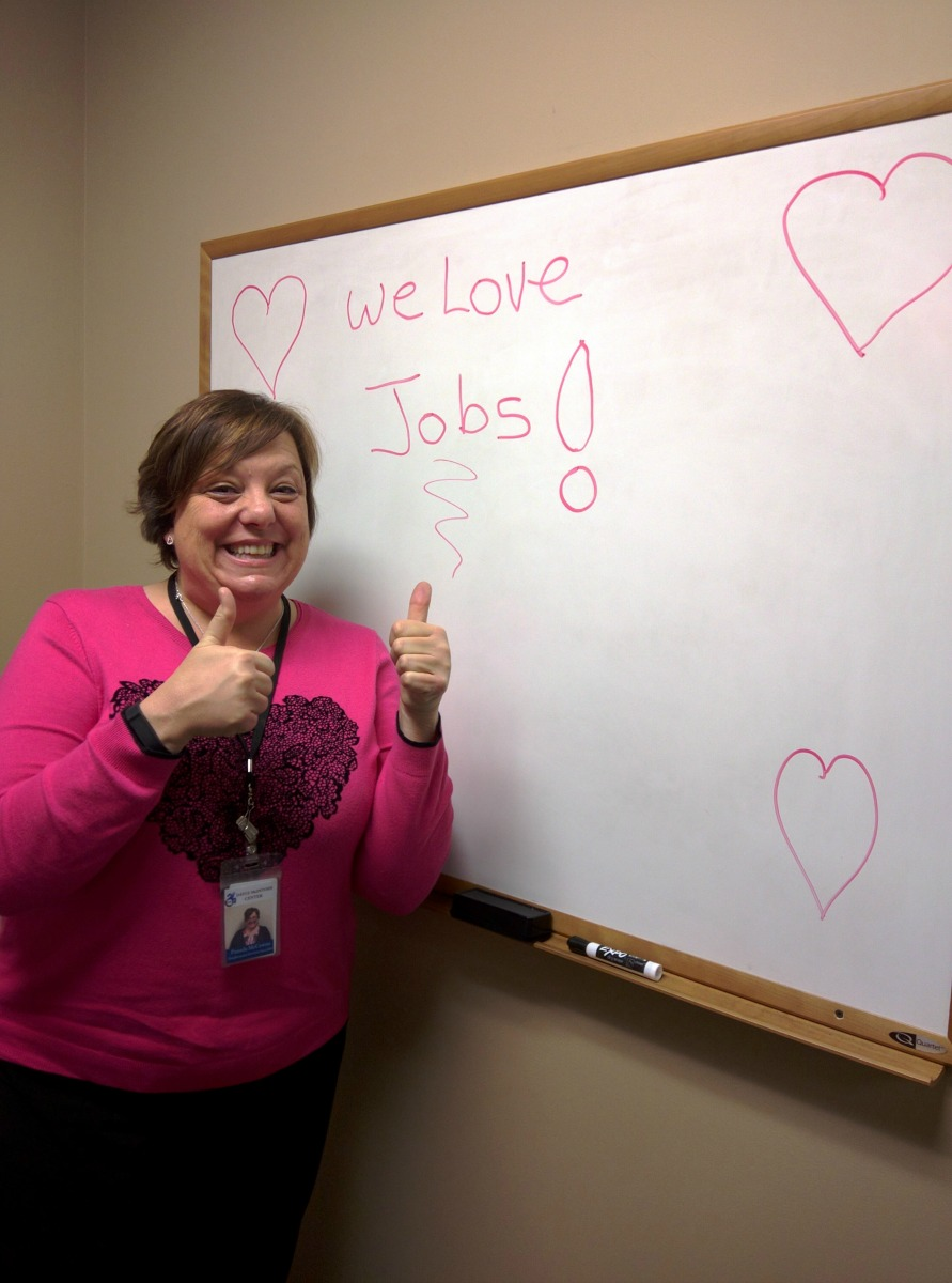 DMC Job Developer, Pam with sign that says we love jobs