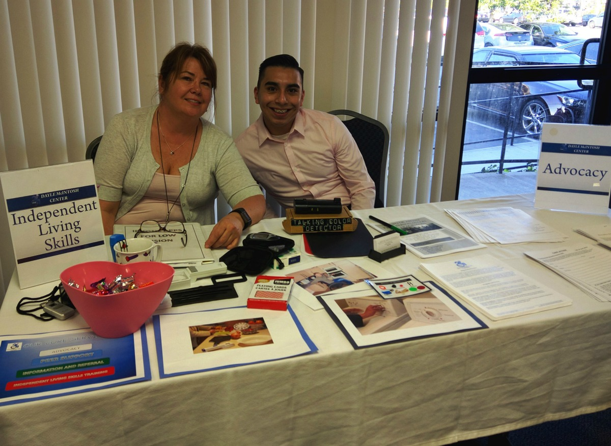 DMC Staff Rony and Jose at Independent Living and Systems Advocacy resource table