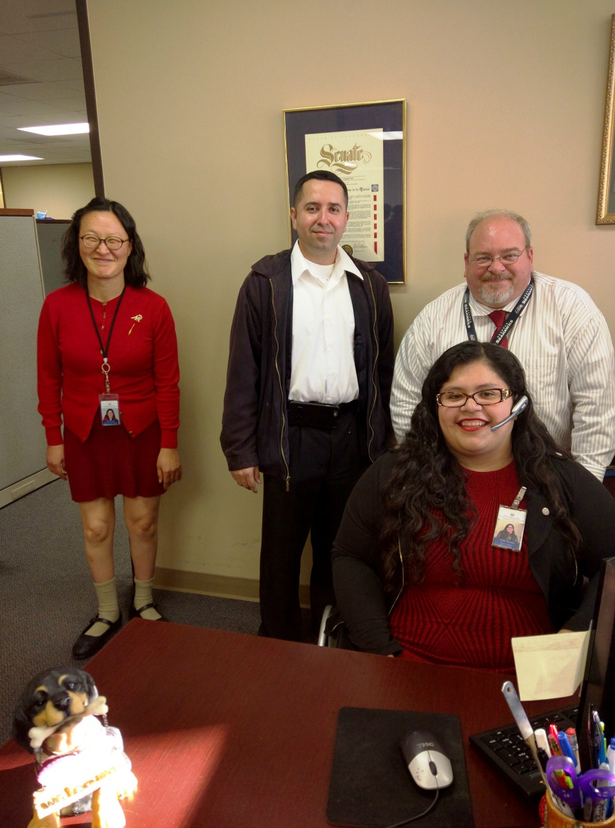 DMC Staff Wendy, Miguel, Bruce, and Nelly at reception desk