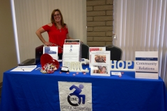 DMC Staff Lani at Community Relations Table