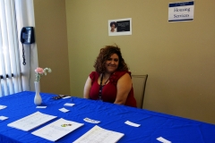 DMC Staff Marisol at Housing Table