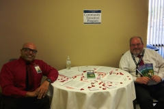 DMC Staff Mir and Bruce at Community Transistion Table