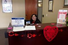 DMC Staff Nelly at reception desk