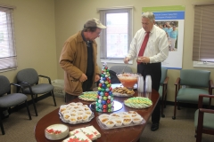 Tim Margeson with guest at refreshment table