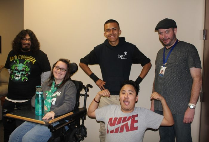 Services Picture of instructor and 4 youth consumers. One youth is flexing his muscles.