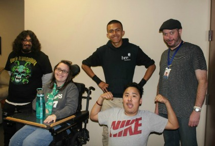 DMC. Picture of instructor and 4 youth consumers. One youth is flexing his muscles. transition services