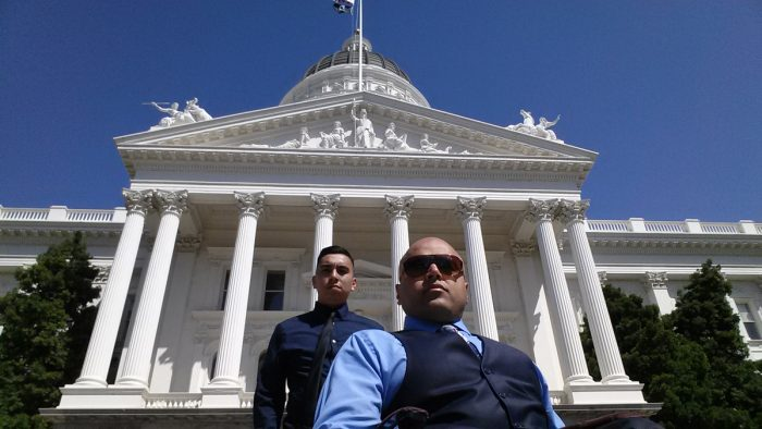Systems Advocacy two male staff posing infront of California State Capitol in Sacramento