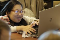 Volunteer picture of girl on lap top.