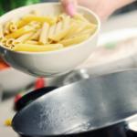 Close up of pan and pasta.