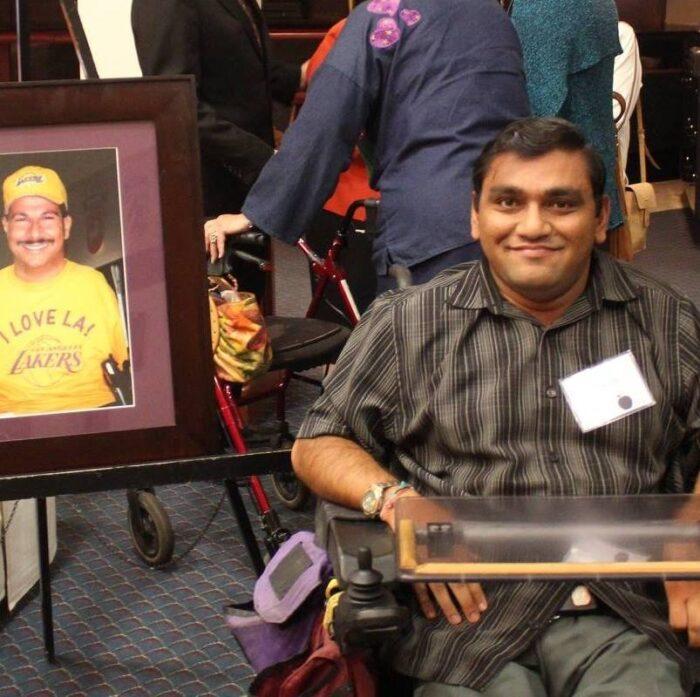 Picture of Bhumit next to a portrait of Richard Devylder